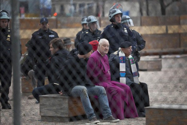 Retired Episcopal bishop Packard and other protesters affiliated with the Occupy Wall Street movement are detained in New York